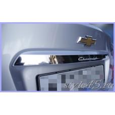 Наклейка на пластиковую вставку багажника Chevrolet Aveo